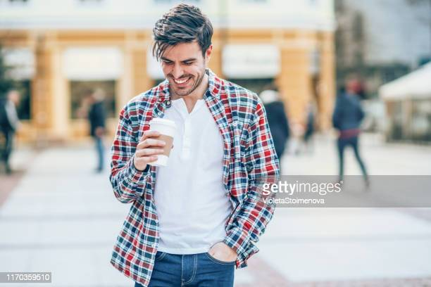 morning walking with cup of coffee - hands in pockets stock pictures, royalty-free photos & images