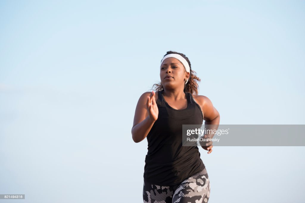 Morning workout of a fat woman to losing weight. : Stock Photo