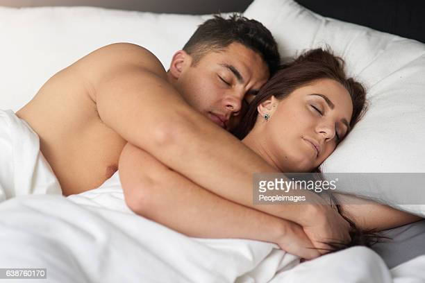 mornings are made of this - romantic young couple sleeping in bed stock photos and pictures