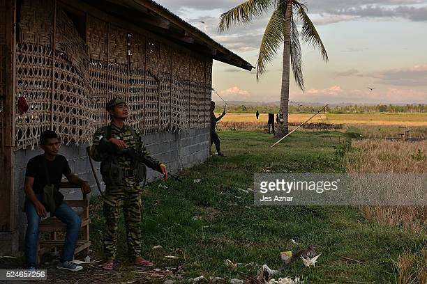 Moro Islamic Liberation Front armed forces takes a position on the lookout for Bangsamoro Freedom FIghters in Midsayap North Cotabato on April 19...