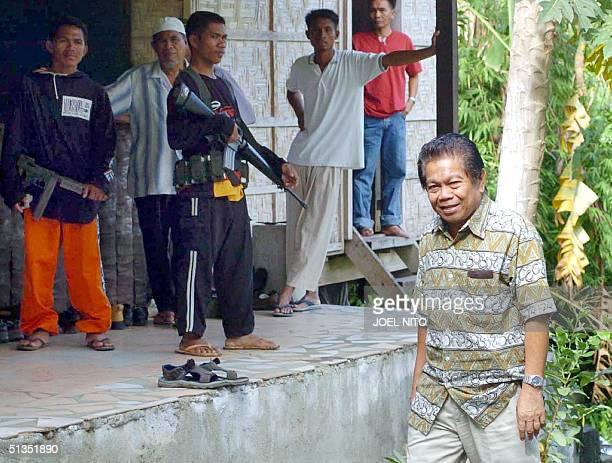 Moro Islamic Liberation Front deputy chef Ghazali Jaafar walks inside a heavily guarded rebel compound in Sultan Kudarat in the main southern...