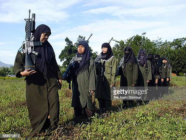 Moro Islamic Liberation Front female soldiers line up at their Camp Abubakar on March 25 2000 in Maguindanao Philippines