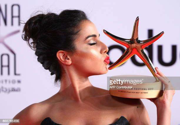 Moroccan actress Nadia Kounda poses with her Best Actress award for her role in Volubilis during the closing ceremony of the ElGouna Film Festival in...