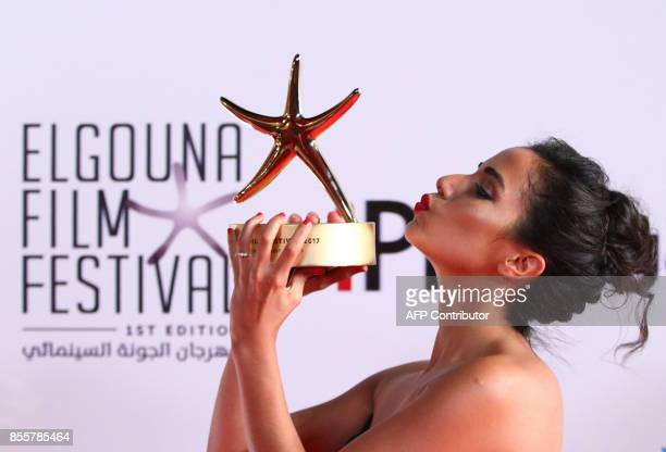 Moroccan actress Nadia Kounda poses with her Best Actress award for her role in Volubilis during the closing ceremony of the El-Gouna Film Festival,...