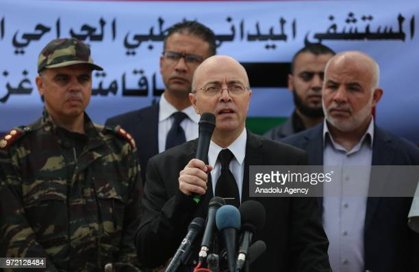 Moroccan Ambassador to Cairo Ahmad atTazi makes a statement during the opening ceremony of a field hospital which was established by Mohammed VI the...
