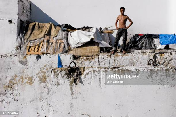 Moroccan boy lives in an improvised shack built on the wall of the the Tanger port, Morocco, 21 January 2007. Every day tens of Moroccan young men...