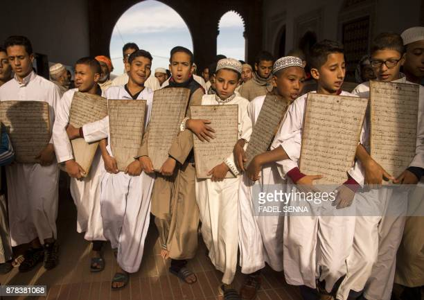 TOPSHOT Moroccan children head to the Great Mosque of Sale to pray for rain on November 24 2017 near the capital of Rabat Parched Morocco which is...