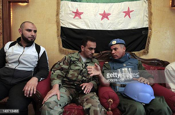Moroccan Colonel Ahmed Himmiche head of the UN observers' advance team speaks with Free Syrian Army commander Abu Kutaiba in charge of the old city...