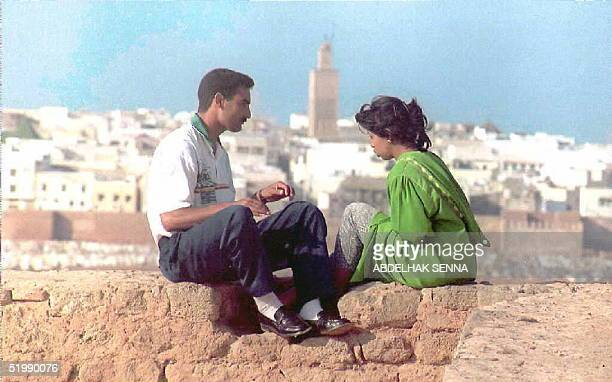 Moroccan couple chats 04 July in a secluded area of the capital Rabat to avoid police A campaign to fight criminality which was lauched several weeks...