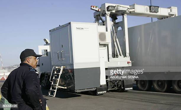 Moroccan customs official watches as a truck drives through a scanner which detects hidden drugs February 15 2008 at the port of Tangiers on the...