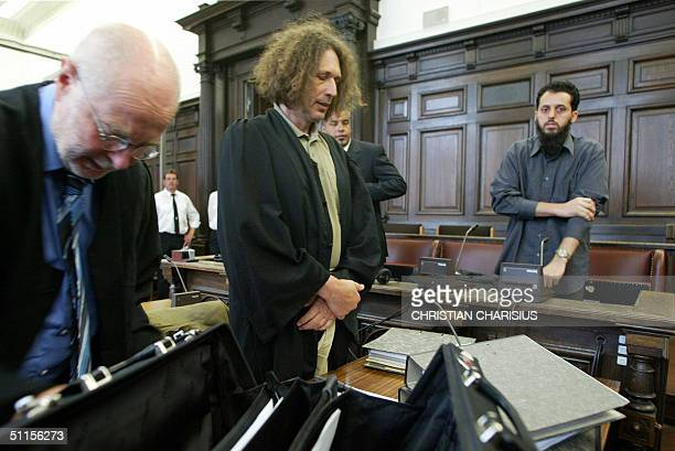 Moroccan defendant Mounir el Motassadeq and his lawyers Josef GraessleMuenscher and Udo F Jacob wait for the start of his retrial in the courtroom in...