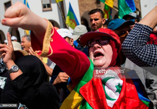 A Moroccan demonstrator draped in the Rif flag gestures as she marches in a protest against the jailing of AlHirak alShaabi or Popular Movement...