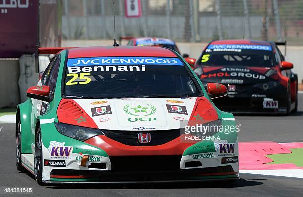 Moroccan driver, Mehdi Bennani steers his car during the qualifying opening round of the FIA World Touring Car Championship on April 12, 2014 at the...