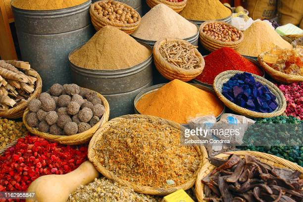moroccan exotic herbs and spices on market stall, retail morocco, africa travel. - exoticism stock pictures, royalty-free photos & images