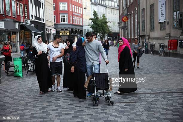 moroccan family walking in copenhagen, denmark. - emigration and immigration bildbanksfoton och bilder