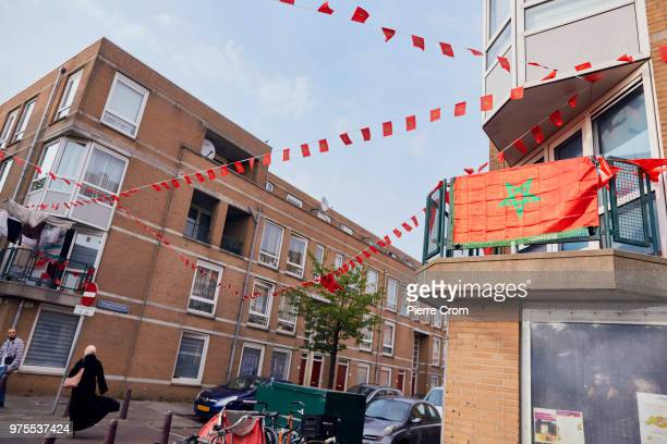 Moroccan flags decorate a street in Schilderswijk a neighborhood in The Hague where the DutchMoroccan community are supporting the Moroccan national...