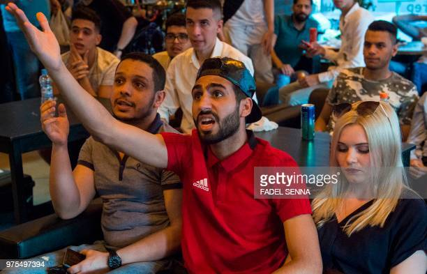 Moroccan football fans react while watching the Russia 2018 World Cup Group B match against Iran on June 15 in Voronezh