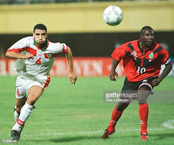 Moroccan forward Nouredinne Naybet fights for the ball with Mozambique Francisco Junior during their game in the 21st African Nations Soccer Cup 13...