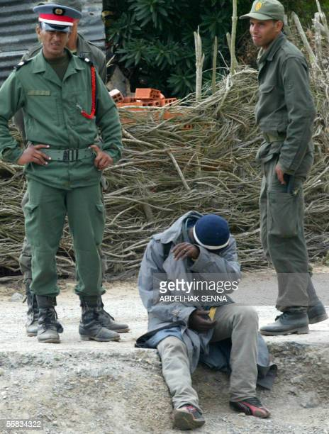 Moroccan gendarmes arrest 01 October 2005 an immigrant during cleanup operations in Benyounech near the Spanish enclave of Ceuta where five...