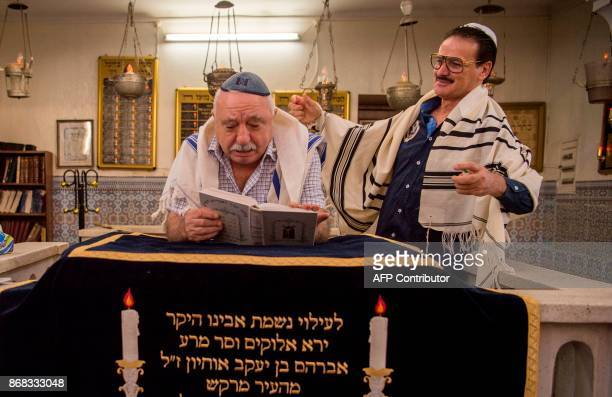 Moroccan Jews and Israeli Jewish tourists participate in a religious ceremony to observe the holiday of Sukkot at a synagogue in the Mellah Jewish...