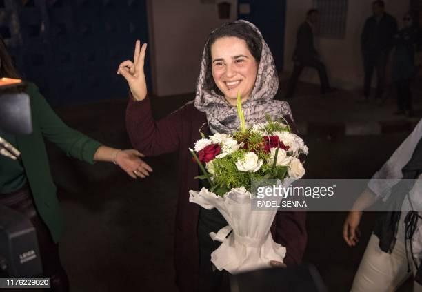 Moroccan journalist Hajar Raissouni flashes the victory sign upon leaving a prison in Sale near the capital Rabat on October 16 2019 Raissouni who...