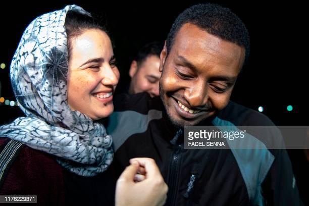 Moroccan journalist Hajar Raissouni is greeted by her boyfriend Rifaat Al Amine upon leaving a prison in Sale near the capital Rabat on October 16...
