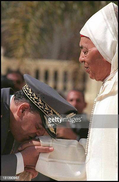 Moroccan King Hassan II receives the kiss of allegiance of Moroccan Army General Abdelhak Kadiri during ceremonies for the 36th anniversary of the...