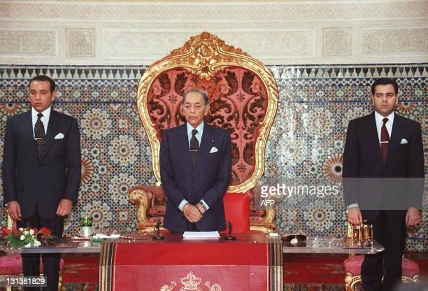 Moroccan King Hassan II stands for the national anthem flanked by his two sons the heir apparent Prince Sidi Mohamed and Prince Moulay Rachid as the...