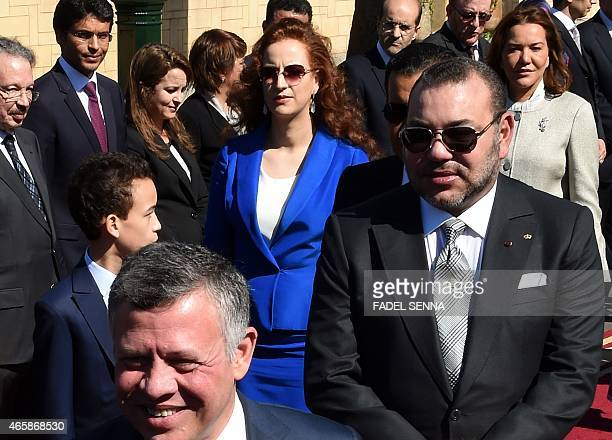 Moroccan King Mohammed VI accompanied by his son Prince Moulay Hassan and his wife Princess Lalla Salma walks alongside Jordan's King Abdullah II...