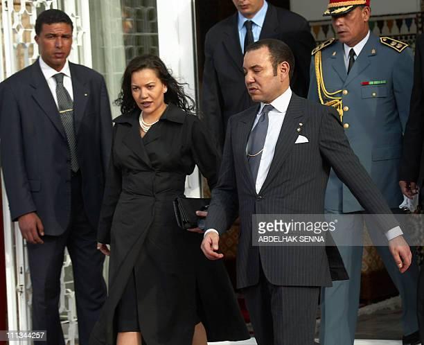 Moroccan King Mohammed VI and his sister princess Lalla Hasna walk together 15 May 2002 in the king's palace in Rabat AFP PHOTO ABDELHAK SENNA