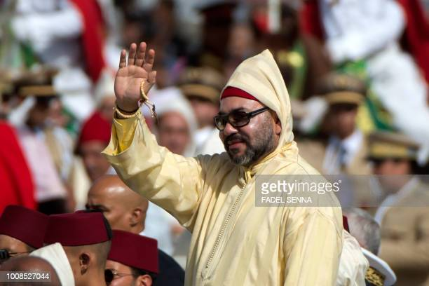 Moroccan King Mohammed VI greets the crowd as he stands in a limousine during a ceremony of allegiance at the King's palace in Tetouan on July 31 to...