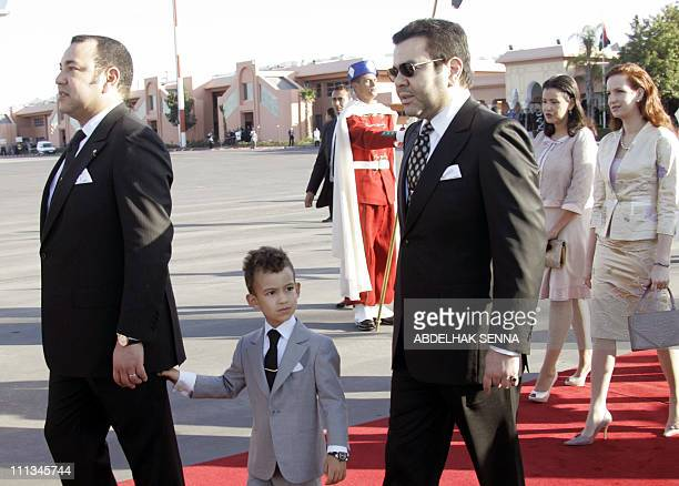 Moroccan King Mohammed VI holds his son Hassan III as he walks with his wife Lalla Salma and brother Prince Moulay Rachid to welcome King Abdullah II...