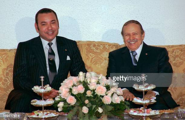 Moroccan King Mohammed VI meets with Algerian President Abdelaziz Bouteflika 21 March 2005 in Algiers on the sidelines of the Arab Summit AFP PHOTO...