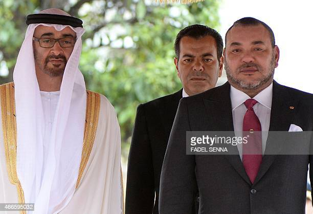 Moroccan King Mohammed VI Moroccan Prince Moulay Rachid and Sheikh Mohamed bin Zayed AlNahyan the Crown Prince of Abu Dhabi listen to their national...