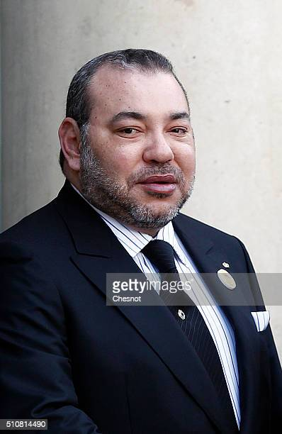 Moroccan King Mohammed VI poses prior to attend a meeting with French President Francois Hollande at the Elysee Presidential Palace on February 17...