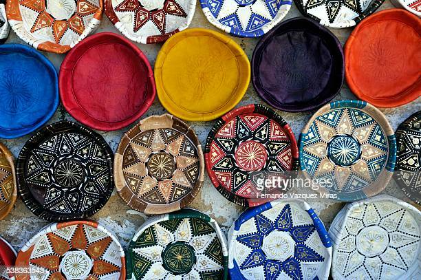 moroccan leather pouffes - moroccan culture stock photos and pictures