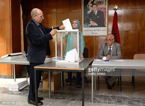 A Moroccan man casts his vote at a polling station in the capital Rabat on October 2 during an indirect vote to elect Morocco's upper chamber of...