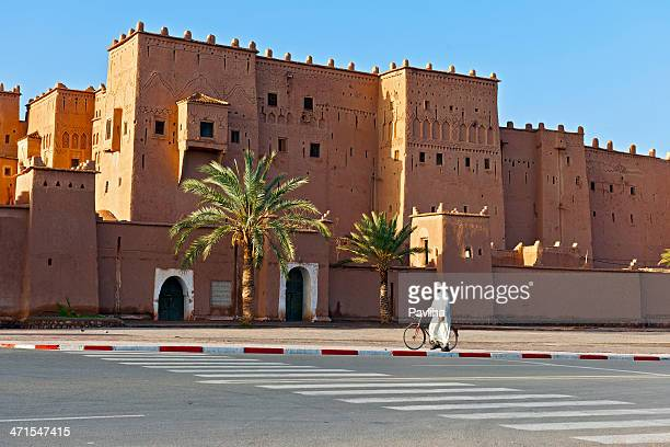 moroccan man passing kasbah taourit ouarzazate africa - kasbah of taourirt stock pictures, royalty-free photos & images