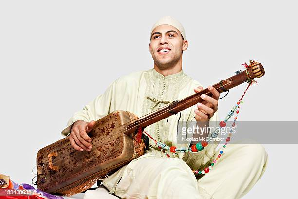 Moroccan Man Playing the Guembry