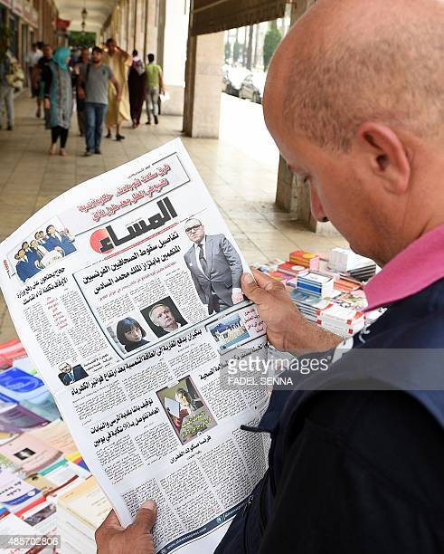 A Moroccan man reads the latest issue of AlMassae daily newspaper in Arabic with on its cover portraits of the two French investigative journalists...