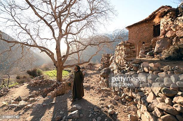 A Moroccan man walks in Zourhoune an isolated village in the elHaouz province in the High Atlas Mountains south of Marrakesh on March 4 2016 When...
