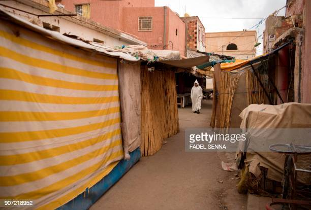 A Moroccan man walks through street during a general strike ahead of a demonstration against economic marginalisation on January 19 in the...