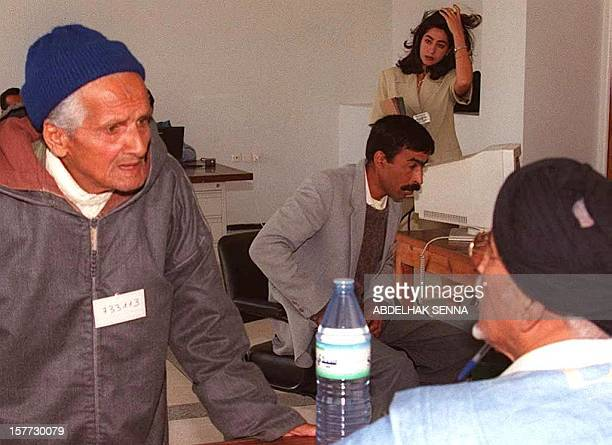 A Moroccan man who wish to participate in a referendum on selfdetermination for the Western Sahara region talks to a Polisario Front representative...