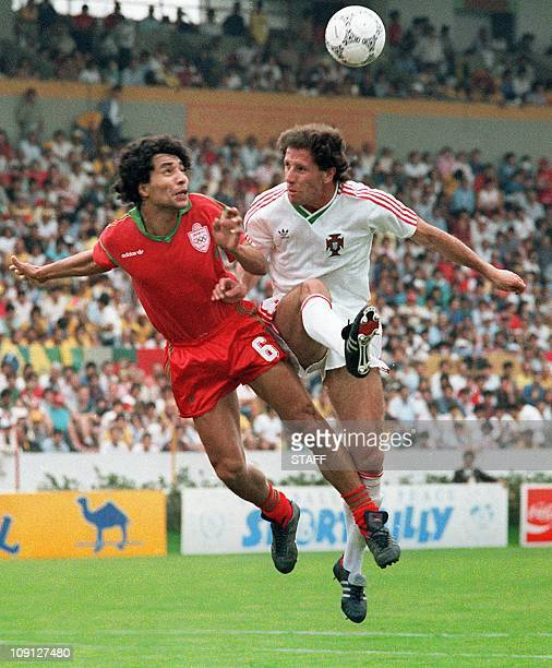 Moroccan midfielder Abdelmajid Dolmy collides with Portuguese Magalhaes as he goes for the ball 11 June 1986 in Guadalaraja during the World Cup...