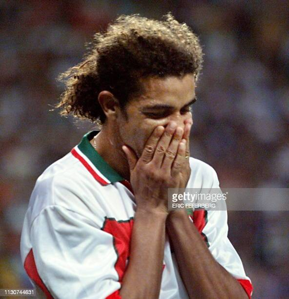 Moroccan midfielder Mustapha El Hadji reacts 23 June at the Stade Geoffroy Guichard in SaintEtienne central France after the 1998 Soccer World Cup...