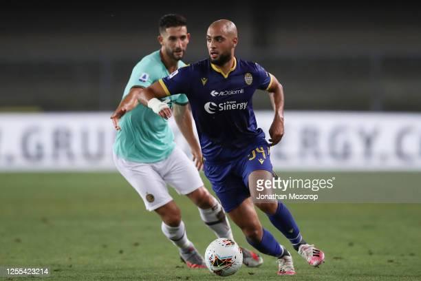 Moroccan midfielder Sofyan Amrabat is pursued by Italian midfielder Roberto Gagliardini during the Serie A match between Hellas Verona and FC...