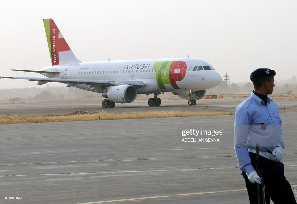 A Moroccan military member stands as the first flight of the day for Portugese carrier TAP taxis prior to the arrival of Portugal's Prime Minister Jose Socrates in Marrakesh on June 2, 2010. Socrates is on a two day official working visit.