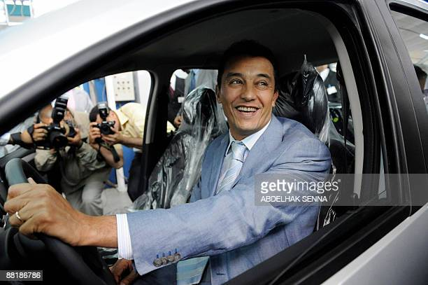 Moroccan minster for industry Ahmed Reda Chami looks on from inside the newly launcehd Dacia LoganSandero in Casablanca on June 3 2009 The Dacia...