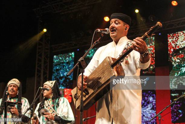 Moroccan musician Hamid ElKasry performs during the 2019 Gnaoua music festival in Morocco's western region of Essaouira on June 22 2019 A wave of...