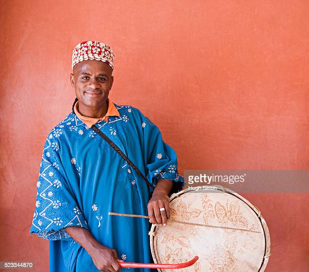 moroccan musician with drum - hugh sitton stock pictures, royalty-free photos & images